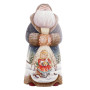 Saint Nicolas sculpté portant un sac